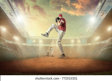 Baseball players in dynamic action on the stadium undet sunset sky with clouds.
