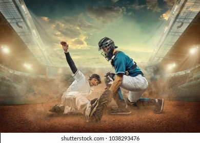 Baseball players in dynamic action under sunset sky and lights of stadium.