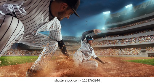 Baseball players on professional dramatic stadium. Baseball tagged out
