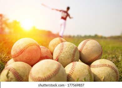 Baseball players practice wave a bat in a field