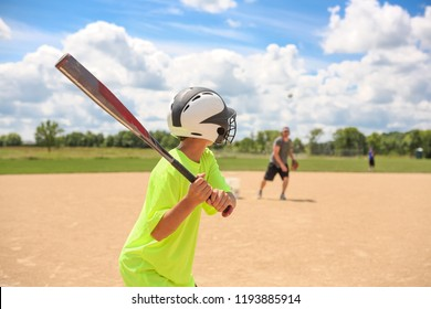 Baseball practice, coach pitching to batter