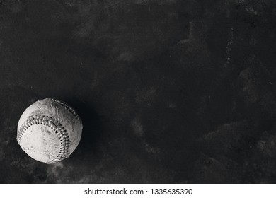 Baseball season banner with copy space in black and white shows old rugged ball closeup.