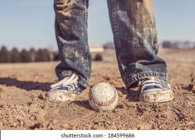 baseball and sneakers in a baseball field