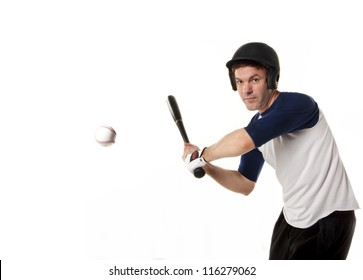 Baseball or softball player at bat hitting a ball and isolated on white.