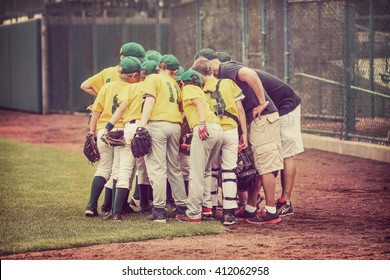 Baseball team in a huddle vintage toned