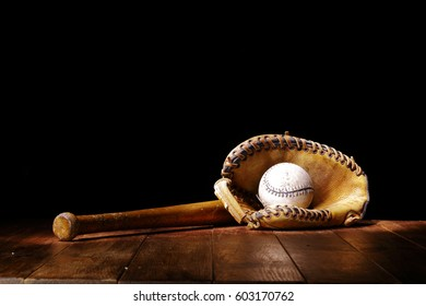Baseball tools on wooden desk space