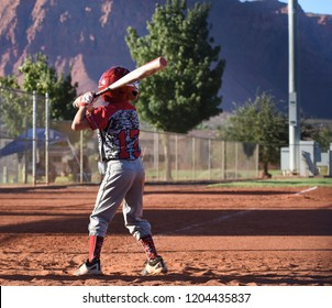 baseball youth player, left handed side of the plate