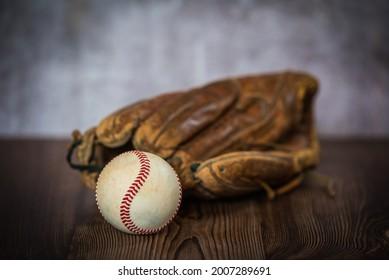baseballglove and ball on vintage background