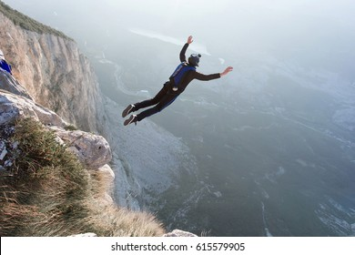 Basejumper jumping from the cliff in Italy