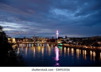 Basel by night during autumn fair.