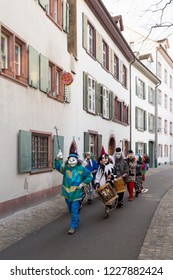 Basel carnival. Martinsgasse, Basel, Switzerland - February 21st, 2018. Front view of a carnival group in the old town