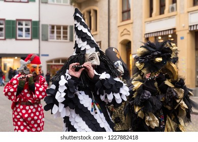Basel carnival. Nadelberg, Basel, Switzerland - February 21st, 2018. Close-up of a beautiful black and white clown costume