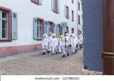 Basel carnival. Nadelberg, Basel, Switzerland - February 21st, 2018. Carnival group in white costumes in the old town