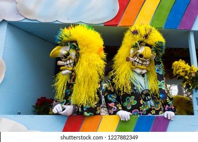 Basel carnival. Steinenberg, Basel, Switzerland - February 21st, 2018. Close-up of two waggis clowns on their carnival float
