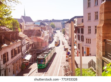 Basel streets with city trams, shops and houses