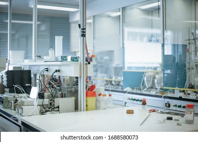 Basel, Switzerland - 05 10 2019: Scientists working in a modern fully equipped biochemistry laboratory. Chemists on the job conducting research for infectious coronavirus disease vaccine.