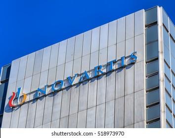 Basel, Switzerland - 27 August, 2016: upper part of one of Novartis buildings, view from Dreirosenbruecke bridge. Novartis International AG is a Swiss pharmaceutical company based in Basel.