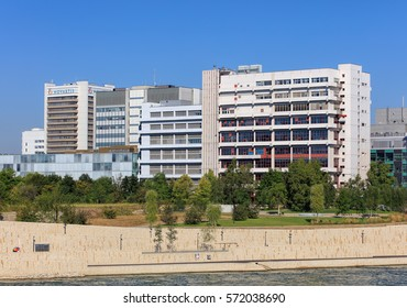Basel, Switzerland - 27 August, 2016: embankment of the Rhine river and buildings of Novartis. Novartis International AG is a Swiss pharmaceutical company based in Basel.