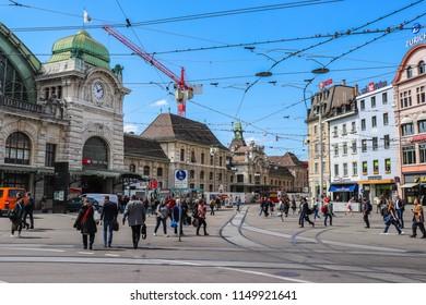 Basel, Switzerland - April 12 2018: People are walking in front of Basel Main Station (Bahnhof Basel SBB)