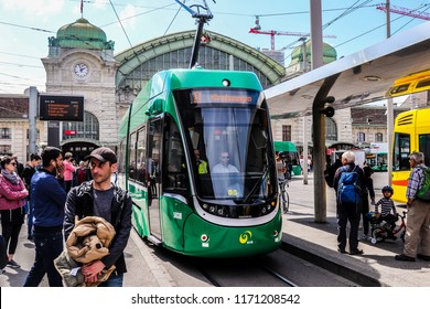 Basel, Switzerland - April 12 2018: People are waiting to take a tram in front of Basel SBB Station (Bahnhof Basel SBB)