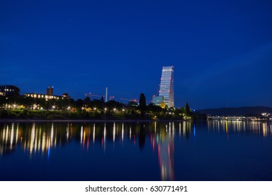 Basel, Switzerland - April 24, 2017: View of the Rhine River with the illuminated Roche Tower