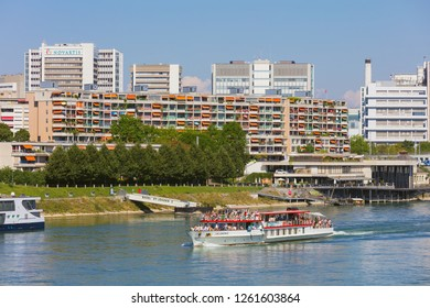 Basel, Switzerland - August 27, 2016: buildings of  the city of Basel, the Lallekonig boat with passengers on board along the Rhine river. Basel is a city in northwestern Switzerland.