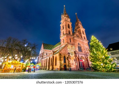 Basel, Switzerland. Christmas fairytale market at Munsterplatz and Munster Cathedral, Swiss Confederation.