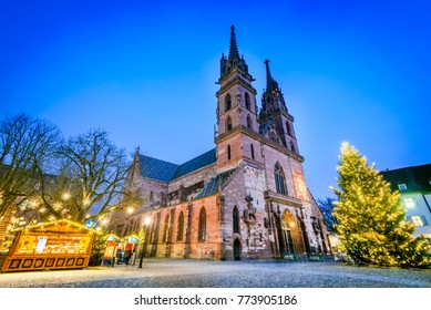 Basel, Switzerland. Christmas fairytale market at Munsterplatz and Munster Cathedral, Swiss Confederation.