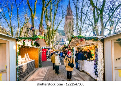 Basel, Switzerland - December 2017. Christmas fairytale market at Munsterplatz and Munster Cathedral, Swiss Confederation.