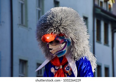 BASEL, SWITZERLAND - FEB 21: Carnival parade on February 21, 2018. A colorful parade of carnival masks in the city of Basel revives a centuries old tradition of masked and costumed performances.