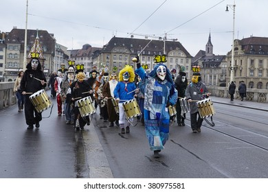 BASEL, SWITZERLAND - FEBRUARY, 15. A carnival clique walks fully costumed through the streets on the morning of the Carnivel at Basel 2016 (Basle - Switzerland) on February 15, 2016.
