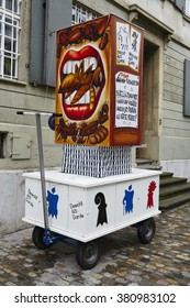BASEL, SWITZERLAND - FEBRUARY, 15. A carnival lantern stands in the street on the morning of the Carnivel at Basel 2016 (Basle - Switzerland) on February 15, 2016.