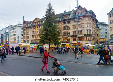 Basel, Switzerland - January 3, 2014: Street view of Marktplatz in the Old Town of Basel. Basel is a third most populous city in Switzerland.