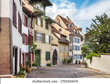 Basel, Switzerland - July 13, 2019: Beautiful street Peterskirchplatz in the center of Basel with historical buildings. Switzerland
