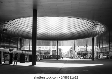 Basel, Switzerland - July 2018: Black and white tone, meeting space at Basel Exhibition Centre under circular hole roof and woven pattern aluminium panel facade designed by Herzog & de Meuron.