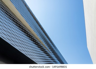 Basel, Switzerland - JULY 2018: Close up detail of woven pattern aluminium panel facade of Messe Basel, Basel Exhibition Center against blue sky in Switzerland.