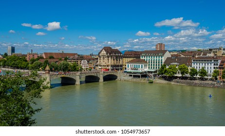 BASEL, SWITZERLAND - JUNE 04 2017: Bridge on the River Rhine, buildings along the river in the city of Basel. Basel is a city on the Rhine River in the northwestern part of Switzerland. Europe.