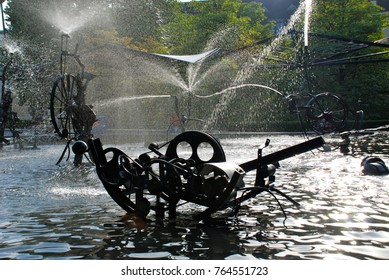 BASEL, SWITZERLAND - JUNE 11, 2011: Closeup of the funny kinetic Jean Tinguely fountain in Basel, called 'Fasnachts-Brunnen' or 'Carnaval Fountain' - Basel was Tinguely's home town.