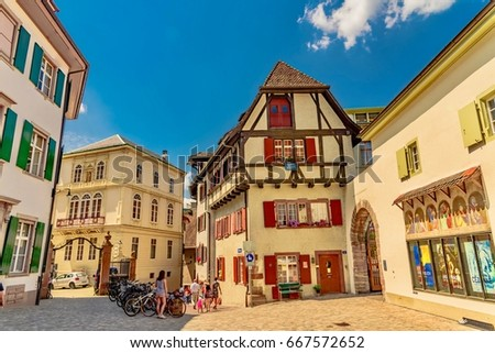 BASEL, SWITZERLAND - JUNE 12 2017:  Old town of Basel with the cathedral above the Rhine river - Switzerland