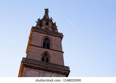 Basel, Switzerland - June 19 2018: Tower of the Basel Minster (church and former cathedral) in Basel, Switzerland.
