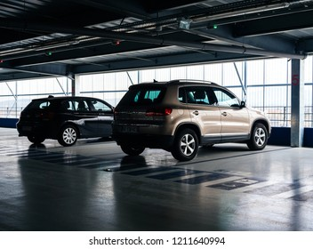 BASEL, SWITZERLAND - MAR 22, 2018: Volkswagen Tiguan SUV and BMW parked in modern supermarket airport covered parking