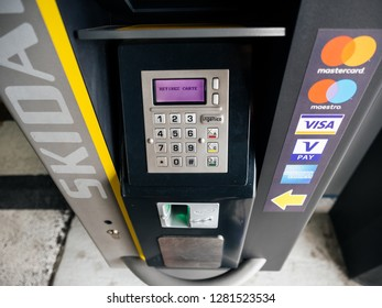 BASEL, SWITZERLAND - MAR 22, 2018: Modern parking machine in airport parking accepting all credit and debit cards from Visa, Mastercard, Maestro, American Express manufactured by Ingenico