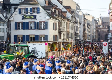 Basel, Switzerland - March 10, 2014: Spectators watching the tradtional carnival parade with dressed up people. The Carnival of Basel is the biggest carnival in Switzerland.