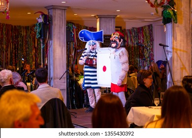 Basel, Switzerland - March 11th, 2019. A group of carnival Schnitzelbaenggler performing their parody poetry in a restaurant