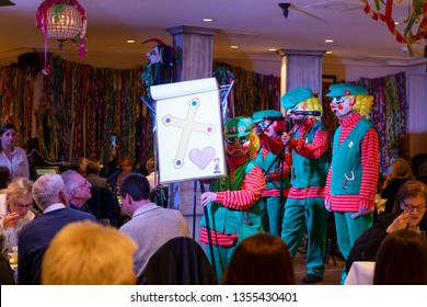 Basel, Switzerland - March 11th, 2019. The carnival Schnitzelbaenggler group called Luuszaepfe performing their parody poetry in a restaurant