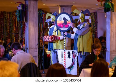 Basel, Switzerland - March 11th, 2019. The carnival Schnitzelbaenggler group called Faerimaa performing their parody poetry in a restaurant