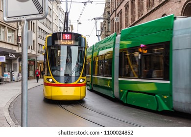 BASEL, SWITZERLAND - MARCH 31, 2018: Trams on a street in Basel. The first line of the Basel tramway network was opened on 6 May 1895