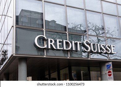 BASEL, SWITZERLAND - MARCH 31, 2018: Credit Suisse signboard over entrance of  Credit Suisse office. Credit Suisse Group is a Swiss multinational financial services holding company