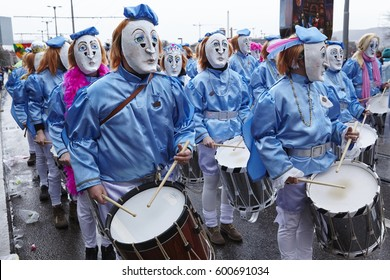 BASEL, SWITZERLAND - MARCH, 6. Some fully costumed carnival activists walk through the city during the carnival procession (cortege) of the Carnivel at Basel 2017 (Basle/Switzerland) on March 6, 2017.