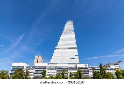 Basel, Switzerland - May 10, 2015 - Office building at the headquarter of the Swiss global health-care company Roche, which operates worldwide under two divisions: Pharmaceuticals and Diagnostics.
